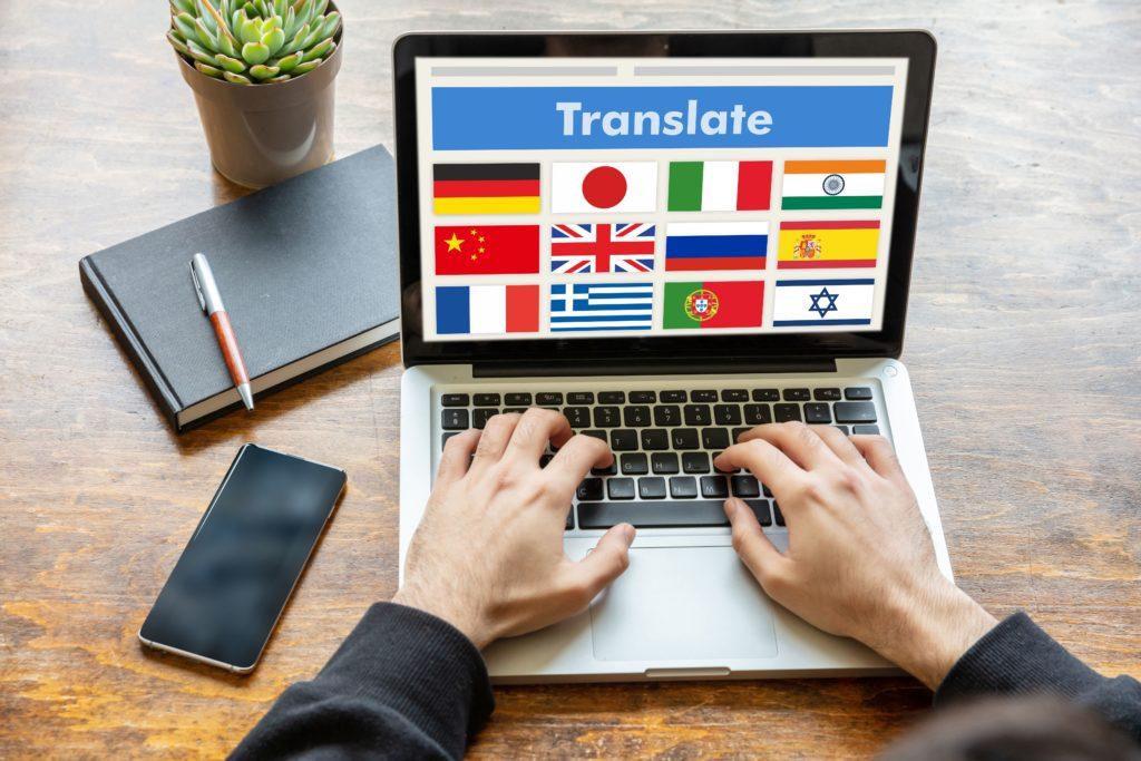 Man Working On A Laptop With The Word Translate On J3a7wlh (1) - RA Soluções Corporativas | Contabilidade no Rio de Janeiro e para todo o Brasil